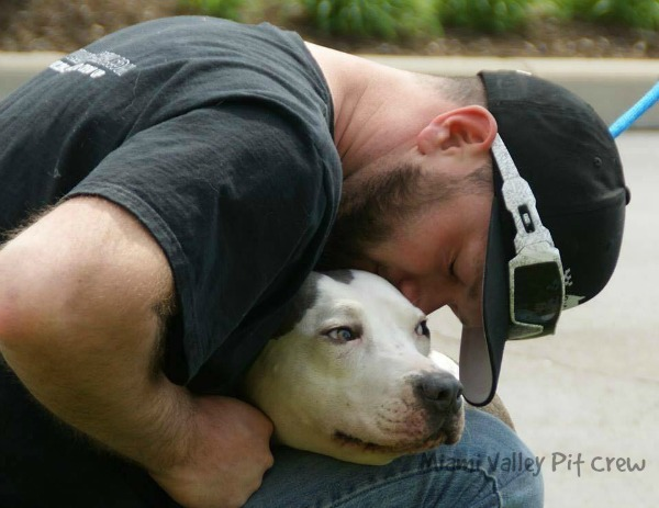 About Miami Valley Pit Crew page Blake holding abused pit bull..